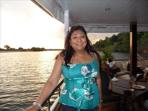 Cruising down the Zambezi at sunset amidst Hippos