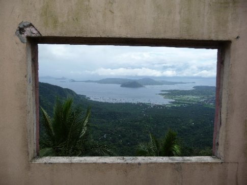 View of Taal Volcano from window of derelict house with a view