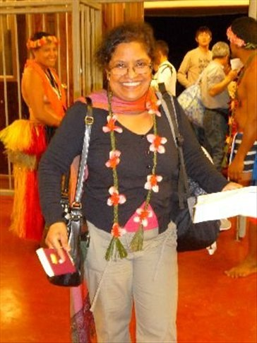 Prabha greeted at Yap airport (by a topless lady) with fresh flower garlands