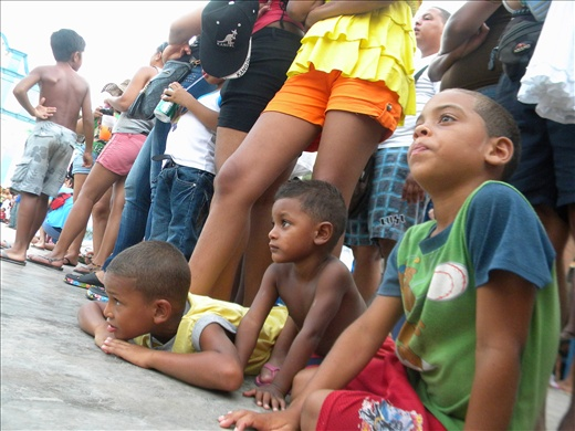 These children watch closely the devil´s submission, looking forward to the time when it will be their turn to pay their pledge to the Holy Sacrament.
