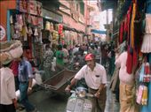 Streets are the veins that carry life blood into these markets. Already narrow, they have been made more impassable by the monsoons. People and goods (mostly as head load and hand carts) find their way through all this and keep the market alive.: by pvijay, Views[470]