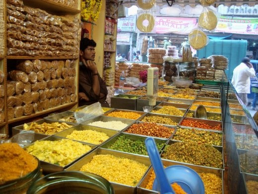 A compendium of tastes, it boasts mouthwatering snacks from every part of India. The variety of them evident from the colour, is true about the tastes too. The shopkeeper however is least affected by the aroma of it all, and has his eyes glued in the TV playing a Bollywood song!