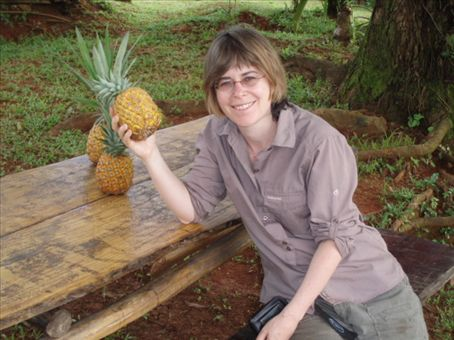 Rachel at the dinner table with one of Marco's home grown organic pineapples!