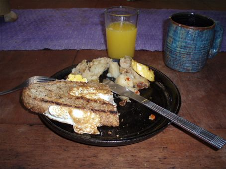 A typical breakfast - egg toast, yucca cakes and plantain, washed down with coffee and fresh fruit juice