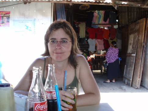 Rachel and I enjoy a cold drink in Granada´s central market, backed by some bible bashers