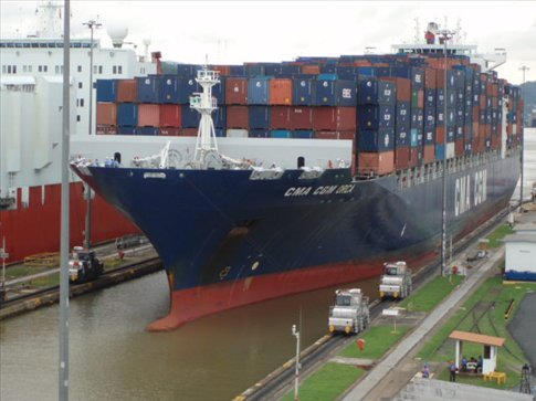 British-registered container ship manouvering through the lock - only 2ft clearance!
