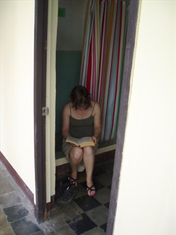 Rachel caught reading....in the shower!  Is nowhere safe?