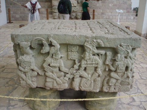 The most famous altar at Copan - the first ruler god passes his authority to the last.
