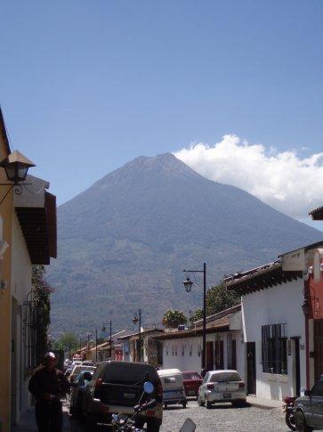 Streetscene with volcanoe looming above, Antigua