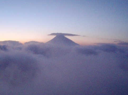 Volcan Agua peeks up through the cloud layer, from Volcan Pacaya.