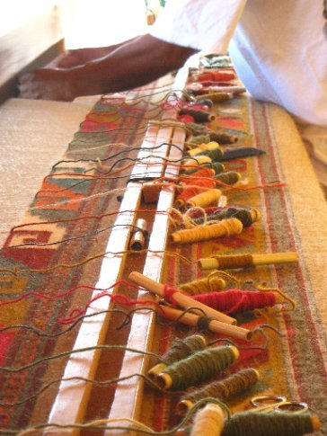 Weaving a carpet by hand on the a giant loom, Teotitlan del Valle