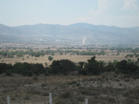 Oaxaca>Mexico City - dust devils skitter across this valley - lots of marginal land has been cleared for agriculture, and the soil is just blowing away...