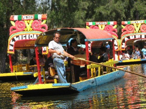 Floating Mariachi bands entertain day-trippers on the Xochimilco canals