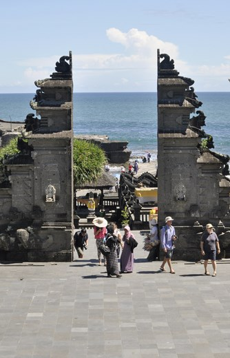 Temples are tourist attractions in themselves in Bali. Many tourists come to the famous Tanah Lot to see the temple on an island in the sea. The Balinese use the temples for worship, but they have become a tourist attraction, and therefore a way to make money.