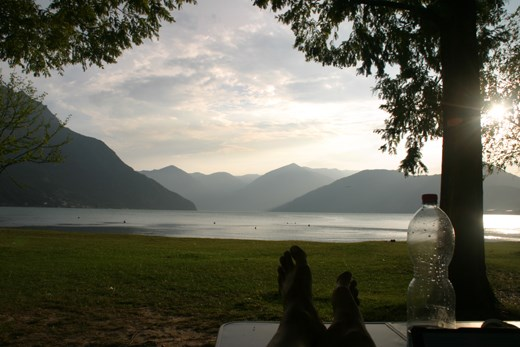 The view from our pitch on the campsite to Lake Iseo (those are Rachel's feet)