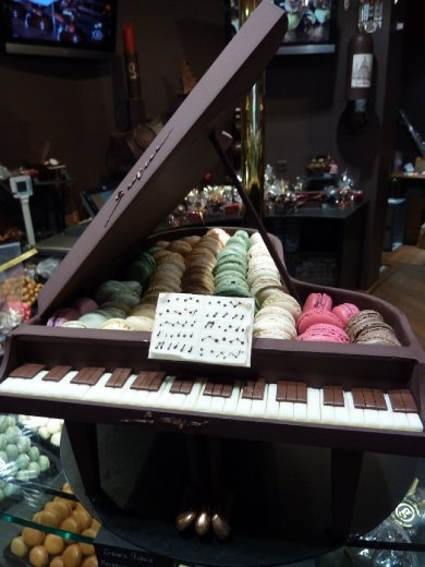 A grand piano made from chocolate with macarons inside. Shame it's too good to eat!