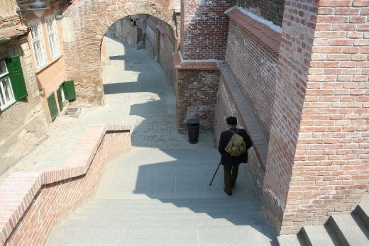 Picture from Sibiu (Romania - Hermannstadt: European Capital of Culture in 2007) - old man on the stairs.