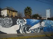 A mural near one of Pablo Neruda's other houses in Santiago, with a spanish telecommunication building in the distance, shaped like an old mobile phone: by ranizo, Views[327]