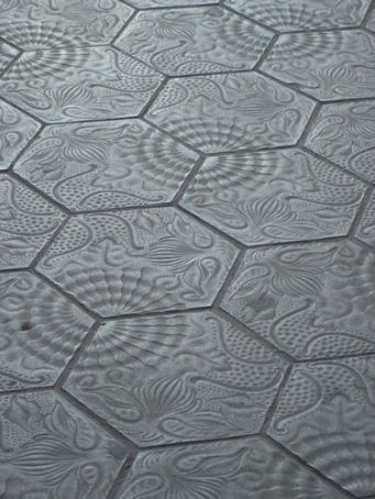 Gaudi designed these for one of his buildings but now they're making them as street pavers...