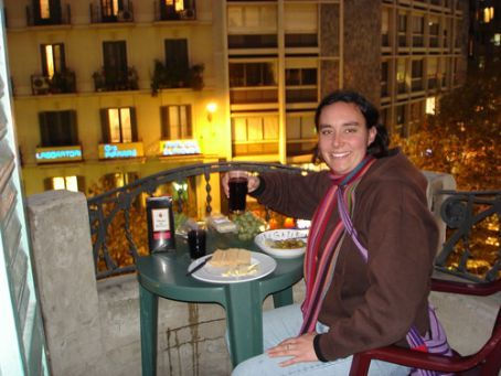 Tash with our home-made tapas on the balcony of our hostel, E1 wine!!