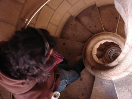 Tash heading down the spiral stairs