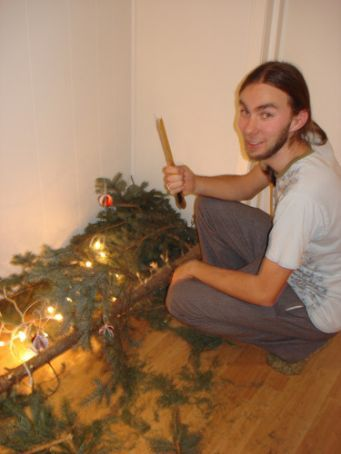 Diccon attacking the chrissy tree with our bread knife (which is now broken!)...  It made a good fire though!