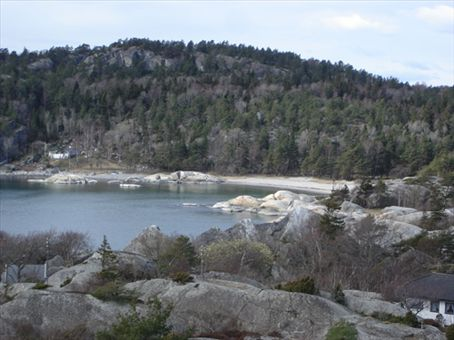And a beach nearby - love the combination of smooth rocks, sand and forest!