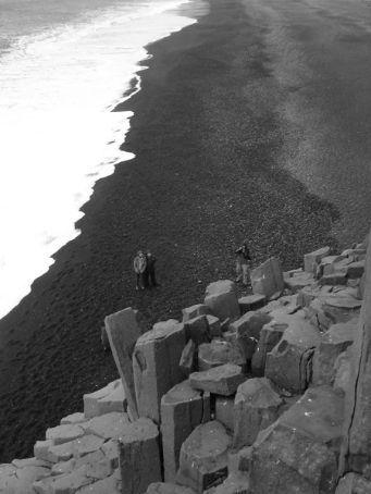 Us watching Diccon climb up the fish-and-chip rocks at Gardar (before Vik)