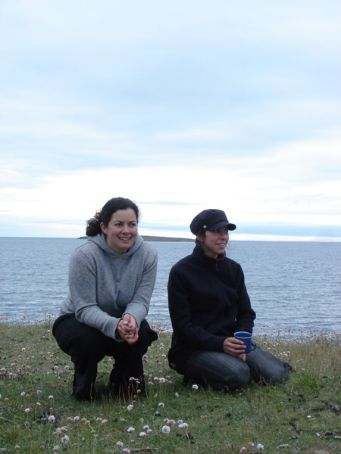 Sarah and I perching among the goose shit watching the boys go gaa-gaa over goslings.... (Reykjavik coast)
