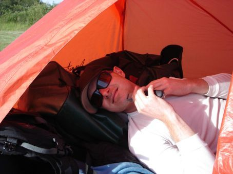 Jamie shaving in his sweat-sack-tent
