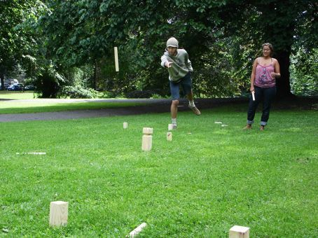 Playing kubb - random Scandinavian game... lots of fun!