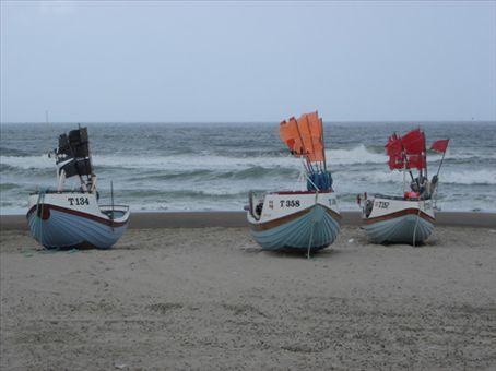 Fishing boats on Stenbjerg beach, NW coast of Jutland