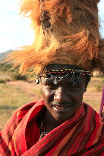 Solomon:  To become a man in the Masaai tribes of Tanzania and Kenya you must kill a lion and bring back it's mane, this then makes you eligible for circumcision and marriage. The man in the photo is Solomon who is wearing a momento of his kill. He was preparing himself for the ceremony later that evening.