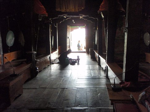 A monk making the offerings for tomorrow
