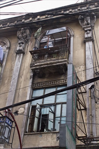 An old apartment influenced by Spanish architecture. Filipino Chinese lives here