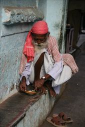 Old man having lunch on the side of the road: by rickshawalas, Views[378]