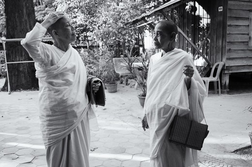 Dressed in their prayer robes, two Buddhist nuns had a brief conversation before entering a temple inside the monastery. 