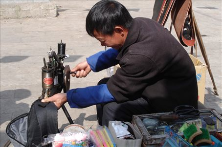 Street shoe mender fixing our $10