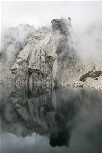 after a foggy day suddenly this rock appeared from the lake