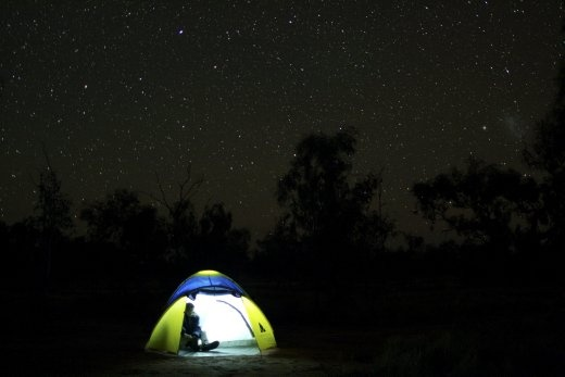 Outback Lights. Pitching a tent at the end of a long day's travel under a million desert stars. Light-years from civilisation, but Home for the night.