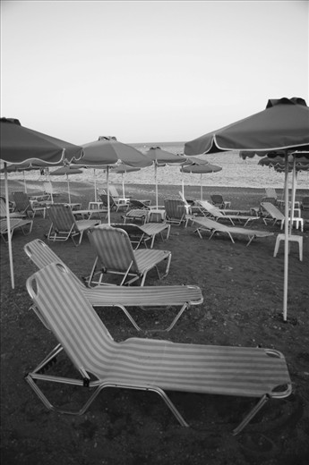 In 2009 I spent three months living in Gennadi, working as a watersports instructor in front of three hotels at nearby Kiotari Bay in the south of Rhodes, Greece. It was quiet in Kiotari. Many of the hotel sun chairs were left empty; a reflection of the slow start to the holiday season as a result of the poor economic climate. Rhodes island is dominated by the tourism industry, with the endless days of sun and consistent wind ordinarily drawing sunbakers and watersport enthusiasts from all over Europe. However at the time, this scene was not uncommon along the east coast beaches.