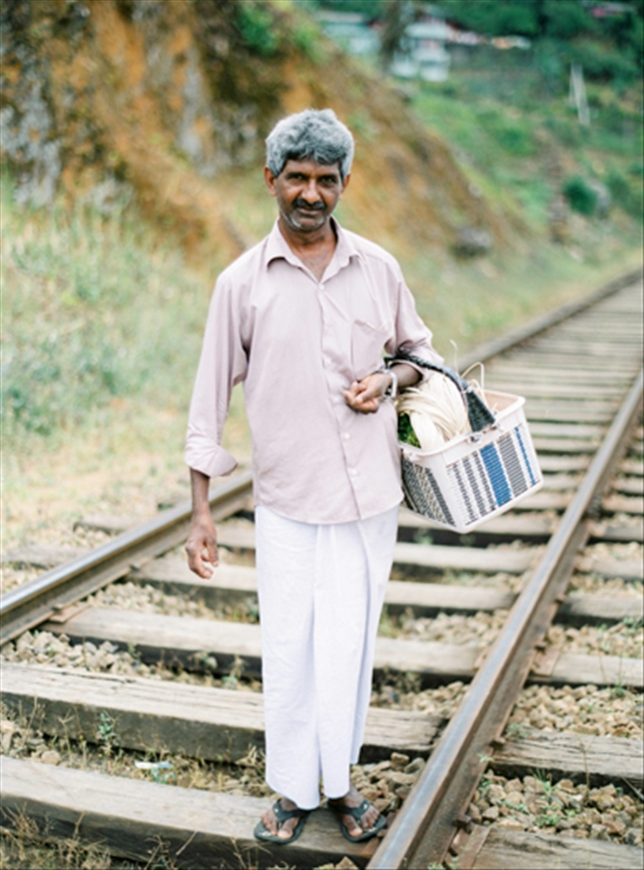 A man follows the railway track back home in the middle of the Sri Lankan mountains