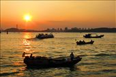 Xiamen is considered a costal city. This photo shows the beauty of Xiamen's clean and beautiful costal area during sunset and the traditional lifestyle of the people amidst progress.: by rodbellezajr, Views[216]