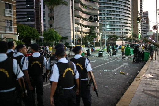 Protesters scatter from their makeshift barriers as police march towards them in a confrontation just outside the public viewing area where fans gathered to watch Brazil's opening match.  Rising costs and misspent funds on lavish stadiums sparked protests across the country.  Brazil will have spent an estimated $14 Billion USD staging the games.
