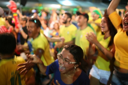 Joy erupts as Neymar's penalty kick puts Brazil up 2-1 against Croatia.  A unifying force in a highly diverse country, the national team would carry the hopes of its 200 million people before eventually falling to Germany in the semi-finals.