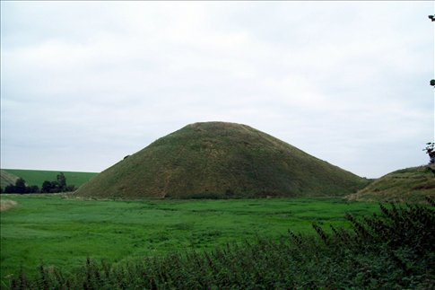 Silbury Hill - 500,000 tons of earth, 4 million man-hours to build, all by hand in 2600 BC)