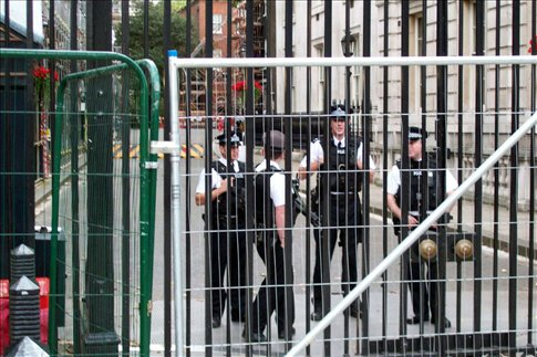 Police guards at the entrance to Downing Street