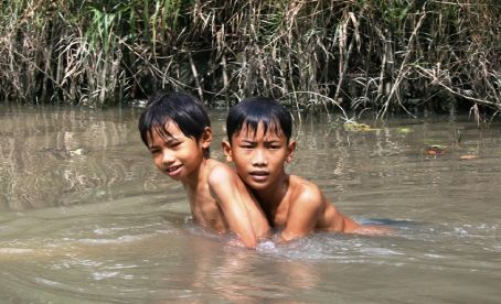 We saw these to little boys floating down the Mekong on a coconut treeas we putted pass them in our whipper snipper canoe.