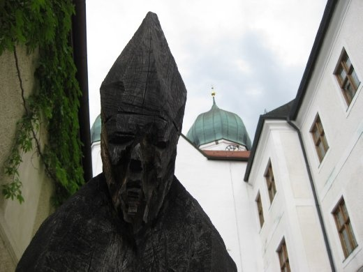 An imposing wooden sculpture along the steps going up to the church.
