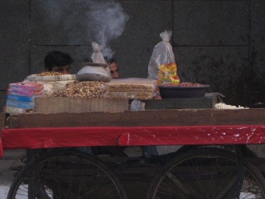 Selling hot peanuts.